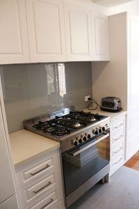 aok kitchen with stove and clean white table