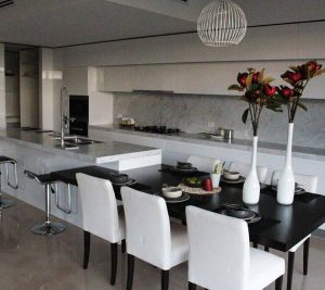 aokkitchens with black table and two flowers