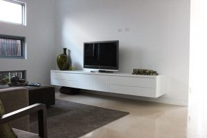 entertainment units with big black tv and sofa