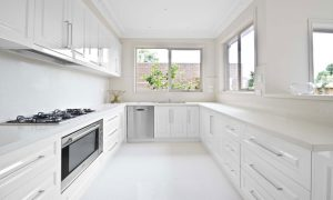 luxury kitchen with white floor and big window
