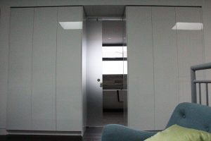 wardrobes with door open and sofa